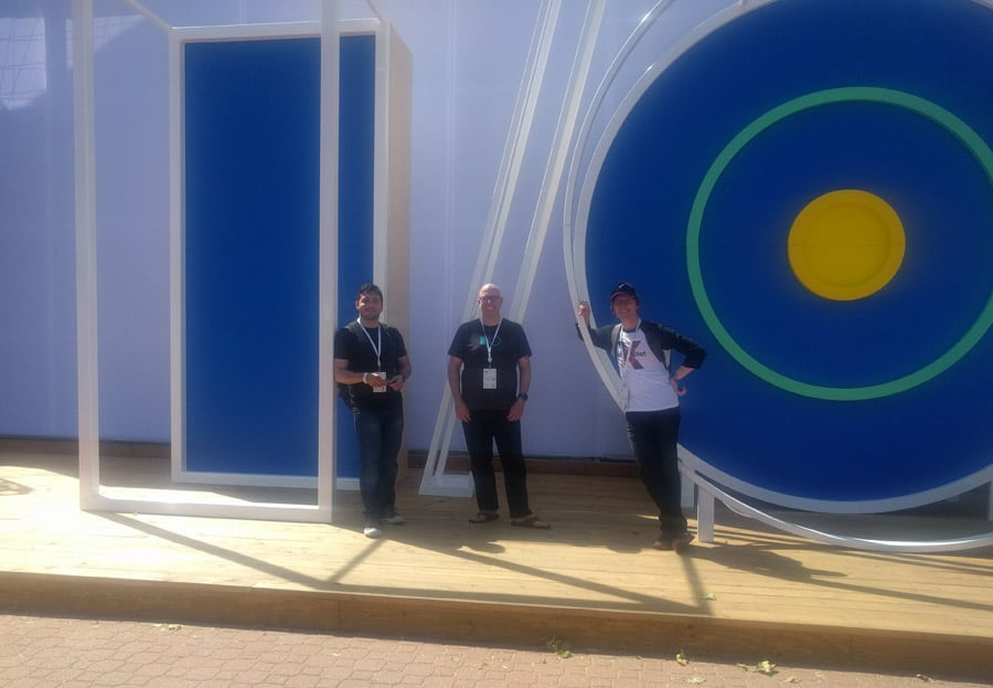 Rocketeers stand in front of Google I/O statue