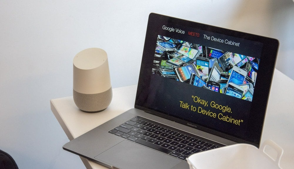 MacBook and Google Home sitting on table